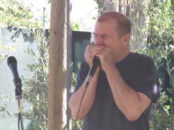 John Kurtyka on the harmonica, photo by Bea Garth