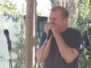 John Kurtyka on the harmonica, photo by Bea Garth